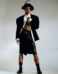 """To me, this is quintessential Ray Petri styling. It's got the tough stance from the model, which is a very sexy, cool stance. He's wearing a leather skirt which is a woman's item of clothing, we have the sexy midriff, strong arms, a touch of vulnerability and a porkpie hat, we're mixing it all. Is he sexy, is he strong, is it aggressive? The vulnerability and strength of a guy and giving a man the same status as a woman."""