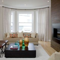 Bow, Curved and Bay Window Coverings Solutions - Elegant and modern window treatments for classic bow windows for a San Francisco residence by Stitch Custom Furnishings.