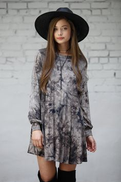 Tie dye lovers, get your swing on. Featuring long sleeves, shift fit, and ultra soft fabric, this dark brown and taupe tie dye dress is perfect with over the knee boots and layered necklaces.