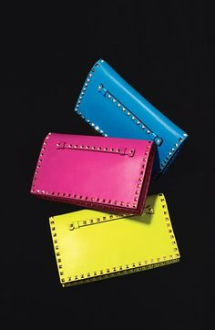 Flap clutches - love the bright colors - great with a black outfit for a pop of color