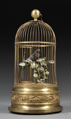 SCIENCE, TECHNOLOGY & CLOCKS - SALE 2600M - LOT 208 - SINGING BIRD AUTOMATON, PROBABLY FRANCE, C. 1900, THE BRASS CASE WITH REPOUSSE DECORATION, SINGLE BIRD WITH AQUA, GRAY, AND BLACK PLUMA - Skinner Inc