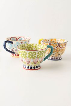 I bought a green and orange one, and look forward to the day when I have disposable income because I'd love to get the turquoise one to make a complete set (hey, three mismatched cups are a set in my world!) ... Because they are adorable, sturdy, and perfect for tea.