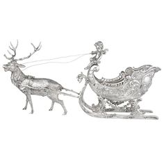 Large Silver Christmas Reindeer and Sleigh Table Top Sculpture | From a unique collection of vintage centerpieces and tazzas at https://www.1stdibs.com/jewelry/silver-flatware-silverplate/centerpieces-tazzas/