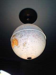 Upcycled World Globes as Gorgeous Pendant Lights