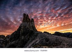 Download this stock image: The Vajolet Towers (Torri del Vajolet). Sunrise colors. The Dolomites, Trentino. - F6494H from Alamy's library of millions of high resolution stock photos, Stock Photo, illustrations and vectors.