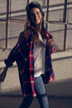 How casual. Plaid polo; shirt; jeans; cap