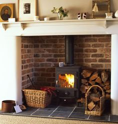 Wood burner in fireplace with log stack. this is brilliant for old homes and nonworking fireplaces Wood Burner Fireplace, Inglenook Fireplace, Fireplace Inserts, Modern Fireplace, Fireplace Wall, Fireplace Design, Fireplace Ideas, Fireplaces, Sitting Arrangement
