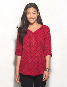 There's something so chic about a red printed top. Add an edgy gold-tone zip detail and you've got one stylish top to pair with all your denim washes. Allover red and black tile print. Imported.