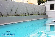 Crisscross green wall design to soften wall next to pool.