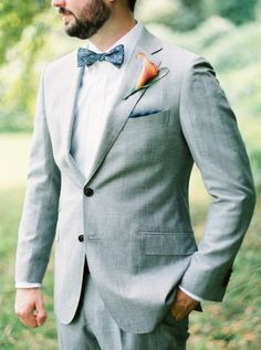 Gray groom's suit and tropical inspired boutonniere: http://www.stylemepretty.com/missouri-weddings/st-louis/2015/12/04/diy-backyard-wedding/ | Photography: Cody Hunter - http://codyhunterphotography.com/