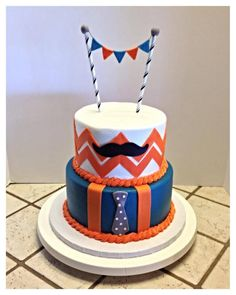 Mustache and tie cake with mini pennants :)
