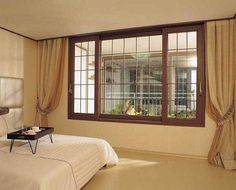 Wood windows are considered as the most famous choice for all the homeowners in London as they bring naturally warm temperature, comfort, b. Wooden Window Design, Window Grill Design Modern, House Window Design, Wooden Windows, House Design, Plastic Windows, Wood Interior Design, Contemporary Interior Design, House Windows