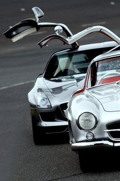 Mercedes 300SL Gullwing Coupe next to its modern reinterpretation, the SLS.