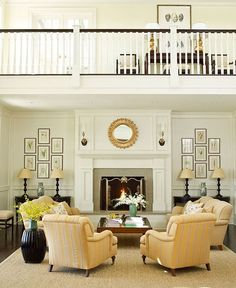 Gorgeous! I would love a banister that overlooks the living room... very Home Alone and Sound of Music. Nice simple layout for a formal living room too.