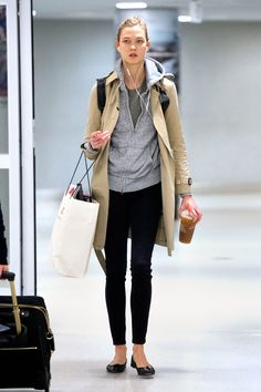 Karlie Kloss Just Wore Your Perfect Holiday Travel Outfit #refinery29 http://www.refinery29.com/2014/11/78608/karlie-kloss-trench-coat-airport-outfit#slide1 Narrowly beating the biggest travel day of the year by a few hours, Karlie Kloss was photographed in New York City at John F. Kennedy International Airport in black skinny jeans, a timeless Burberry trench, and Repetto ballet flats. And an iced Dunkin, because she's human, too. #style