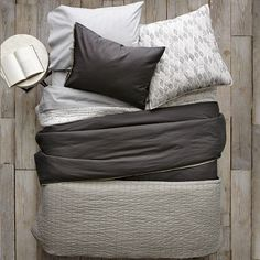 layered bedding look from West Elm