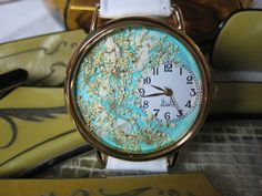 The flowers in this watch are Queen Anne Lace and Alyssum lying on my hand painted turquoise background. Queen Anne Lace stands for fantasy and