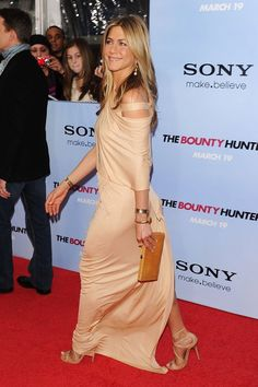 Jennifer Aniston on the red carpet~ She has on a beautiful evening gown and I love how it's off the shoulders.