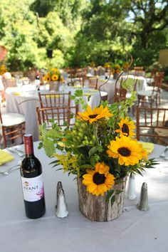 Sunflower centerpieces with wooden bases