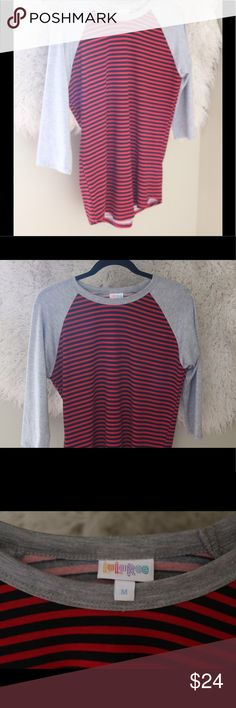 "LuLaRoe Randy Medium Stripe T Shirt Red Black Adorable LuLaRoe Randy top.  Size medium.  Three fourth sleeves are gray.  Body is red and black striped.  96% spun polyester, 4% spandex.  Machine wash.  Hang dry. In good, preowned condition with little wear.  Measures 19.25"" pit to pit, 27"" shoulder to waist.  No trades, offers welcome. LuLaRoe Tops Tees - Long Sleeve"