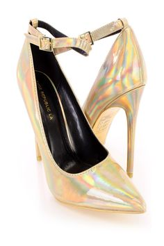 These sexy and stylish single sole heels include a faux leather upper with a holographic finish, scoop vamp and pointed closed toe, ankle strap with a side buckle closure, smooth lining, and cushioned footbed. Approximately 5 inch stiletto heels.