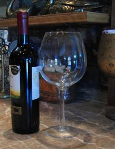 "The XL Wine Glass holds 1 bottle of vino. Stop making trips to your kitchen for more. Great for parties and gifts! Party in a new style with the Xl Wine Glass. It's just over 9"" tall and holds 750ml (25oz). Wine is good!"