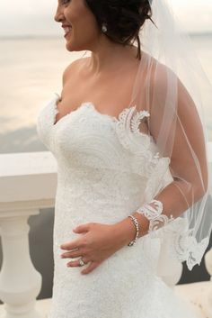 Waterfront Bridal Portrait with V Neck Sweetheart Lace Allure Wedding Dress and Lace Edged Veil | South Tampa Wedding Photographer Caroline & Evan Photography