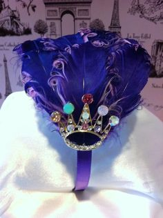 Tiara Jeweled Lavender and Pink Curly Goose Feather Headband. $40.00, via Etsy.