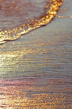 I absolutely LOVE how the color of the sun's reflection onto the water was captured. The waves look gold and has a slight rainbow effect on it. The colors are beautiful and the entire image looks seamless and harmonious.