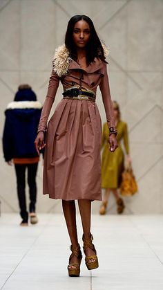 Love the fur colar on the trench and the belt as well.  Super cute trench!!!    Burberry, Silk Blend Trench Coat, and comes in Black, Pink, and Blue.