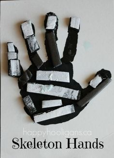 Skeleton Hands Craft - really basic supplies; super-easy Halloween craft for toddlers and preschoolers. (happy hooligans)