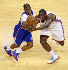Los Angeles' Chris Paul (3) and Oklahoma City's Kendrick Perkins (5) try to control the ball during Game 1 of the Western Conference semifinals in the NBA playoffs between the Oklahoma City Thunder and the Los Angeles Clippers at Chesapeake Energy Arena in Oklahoma City, Monday, May 5, 2014. Photo by Bryan Terry, The Oklahoman