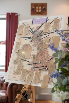 United Kingdom vintage map table plan with kraft paper luggage tag table names- Image by Fiona Kelly - Annasul Y Wedding Gown And No 1 By Jenny Packham Bridesmaids For A Rustic Wedding At The Thames Rowing Club With Groom In Kilt And A Touch Of Tartan Theme