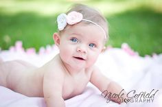 6 month baby milestone photography session - on a blanket outside - keep it simple with just a headband!