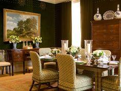 Moody, classic dining room. Love the nail head detailing on walls. (Via Phoebe Howard)