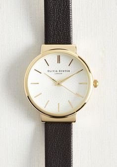 You'll treasure the memory of when you first laid eyes on this classic Hackney watch by Olivia Burton. This vintage-inspired timepiece features an ivory dial, minimalist numerals in glistening gold, and a simple, black leather band that reflects your timeless style.