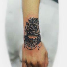 Rose mandala wrist tattoo