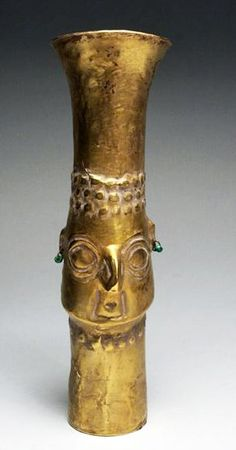"Pre-Columbian, Sican - Chimu Culture, North Coast Peru, ca 800-1000 CE. Crafted from high karat sheet gold, drinking vessel features face of the god Naylamp wearing Gold Ear Rings with turquoise beads, hair on reverse beautifully done in repousse. 70.3 gram weight. 8""H."