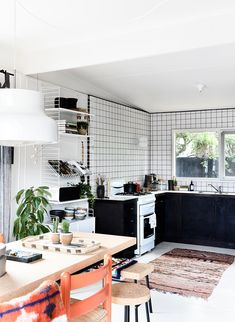 """Simone splurged on three things in the kitchen – she tiled to the roofline to help zone the space, and chose a [Santa & Cole](http://www.santacole.com/en/