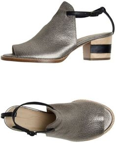 Yoox is killing it with the two-tone pattern heels and the buckling ankle strap closure on these sandals.