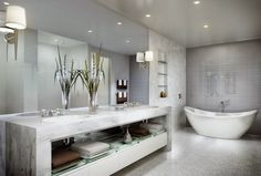If you have a large spa bathroom, you can visionary approach to the lighting, for example, access to pendant lights, hang them above all on a sunken hot tub. Even small pendant lamps in simple shapes and in groups of three are here better than large pendant lamps. You must also make sure that you only use waterproof pendant lights in this area.