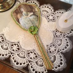 Jeweled hand mirror in green and clear jewels by cindysvictorian