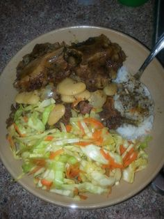 Oxtails jasmine rice and cabbage with butter beans