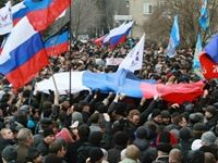 Pro-Russia protesters took over the first floor of a government building in Donetsk in east Ukraine. The building is one of many in east Ukraine that have a Russian flag on top.
