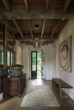 door, wood beam ceiling, floors, lantern, bench, mossy planter