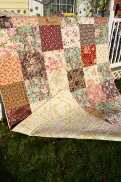 Hand made completely by myself in my home sewing room in Historic Bucks County, PA. This is a traditional looking yet cottage chic quilt in all patterns of beautiful roses floral fabrics in creams, browns, red and teal blue. These fabrics, along with the simple block setting,