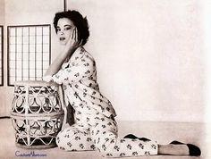 Gloria Vanderbilt wearing Christian Dior 1954