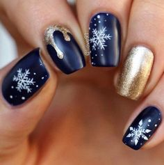 blue, white and gold dripping snowflakes nail art