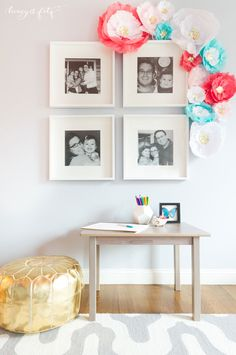 We love a classic black and white gallery wall with family photos in a kids room - plus, how fab are those DIY'd paper flowers?!