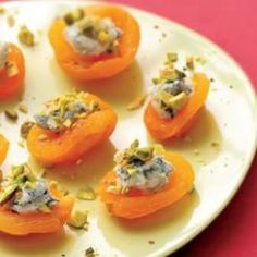 Apricot Canapes.  16 dried apricots  8 teaspoons crumbled blue cheese  2 ounces chopped shelled pistachios  1/2 teaspoon honey  Freshly ground pepper  Top each apricots with 1/2 tsp cheese.  Sprinkle with pistachios and drizzle with honey. Sprinkle with pepper.